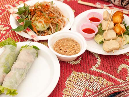 An assortment of Cambodian foods, rice paper rolls and papaya salad