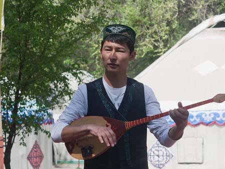 Kyrgyzstan man playing the komuz and singing traditional music