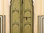 Beautiful decorated green wooden door