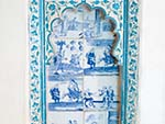 Scenes of westerners in a pastel blue decorative frame