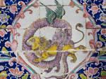 Colourful painted tiles featuring a dragon and lion fighting