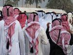 Men wearing traditional Keffiyeh leaving the parade