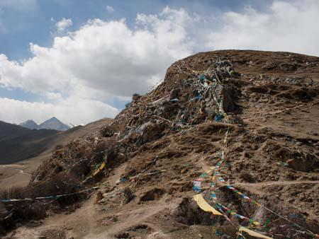 A spider web of prayer flags on the hill