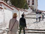 Sonya and the guide Demdul climbing the stairs to the Potala