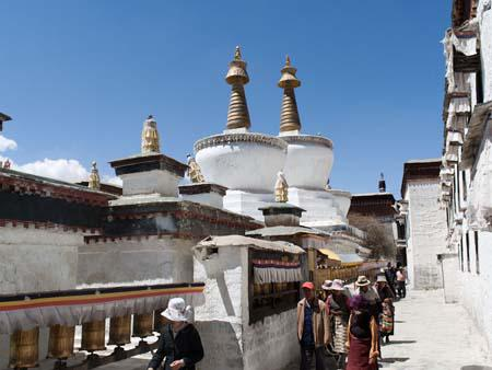 Buddhists circumambulating the three large chortens